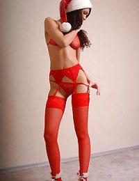 Young sexy sensual Santa Claus poses indoor.