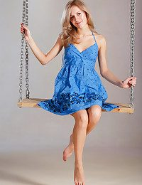Tamara playfully poses on a swing, lifting their way dress' cooky erroneously to flash their way smootj, shaven pussy.