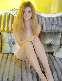 Girl posing on sofa