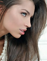 Classic white setting graced by an elegantly beautiful brunette.